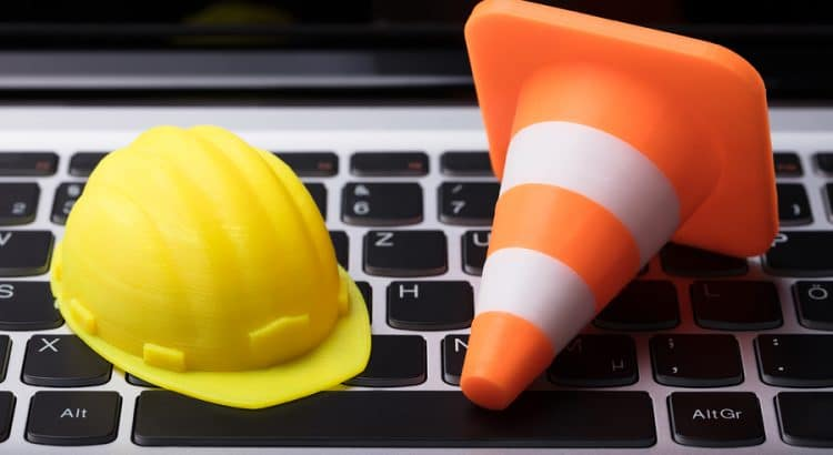 Image of a hard hat and a construction cone